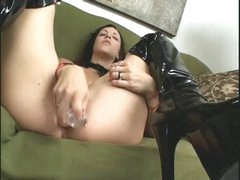 Horny girl in darksome latex boots masturbates