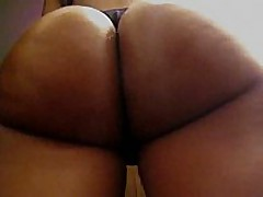 This non-professional ebony honey has a consummate round butt, it looks even more good with her black thong on, and the way she's flexing it in this clip makes everybody drool.