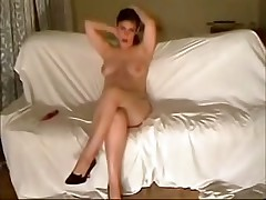 This curvy fem felt very shy posing before her BF's cam at first but then she relaxed and teased him with her full boobs and soaking pussy.