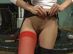 Sexy gal with red nylons in her twat doing indecent things with her sex toy