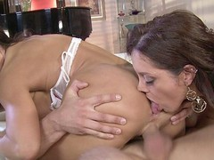 Dark Brown MILFs Francesca Le and Lisa Ann love to share, especially when it comes to sex.  They take turns French giving a kiss and feeling each other's bodies in advance of going to work on this lucky guy's hard rod.  They have a wild time taking turns banging him in advance of they kneel down for the double facial.