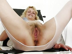 This chubby blonde women is sitting on gynecologist table wearing only a pair of white pantyhose. That babe have large love melons and hairy large pussy. The whore is horny now so that babe starts playing with her large vagina. Surely that babe crave to permeate her love tunnel with something large and thick like a giant dildo.