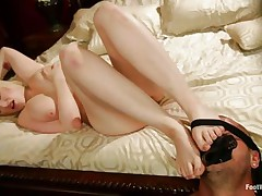 Siri is a pretty blonde with big natural breasts, milky white skin, red delicious lips and a pair of sexy legs. She is rubbing the guy's hard dong with her feet, pleasuring him and that guy sucks her toe with gratitude. Her voluptuous body makes u wonder if that guy will cum on her, especially on those sexy feet!