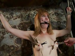 She is about to receive a harsh punishment that will satisfy her lust for pain. The executor inserts a device in her mouth and puts laundry pliers on those cute small tits, inducing her all the pain she needs to be satisfied. The weight is pulling her down but she's tied and slowly, her pussy gets ready to be fucked.