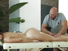 Look at this gorgeous brunette having a massage on her long hot legs and her sexy body. Just at the view of her moistured ass and her tight pussy she gets the guy all horny and makes him wanna give it to her deep. Do you think she needs some semen with all that oil or a big hard cock in her cunt?