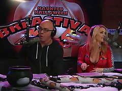 On Playboy Radio's Morning Show, three dressed-up hotties are racing against the clock to make a ghost costume. The in-studio guest is acting as a judge as well but the girls are having trouble. The male host goes to help and the winner is the short girl who cut out breast holes in her sheet.