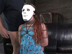 Hope Claire loves games cuz she's part of one. The nice-looking redhead wears a mask but not for long, in a short time her mask is removed and she is knelt in front of her executor's cock. He grabs her by the head and starts mouth fucking this bitch hard and merciless. Is Claire going to gag with his semen?
