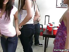 Two of the college sluts are showing their butts to the camera, then one of 'em is doing a lap dance to a guy. Like any party in college, the women are either flashing their tits or doing body shots. After drinking a lot of tequila, three women are having a threesome in front of their friends.