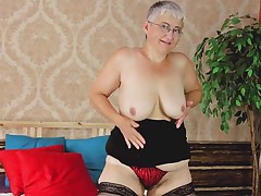 Don't be surprised! Old women wants to feel sexy every now and then too! Granny wears stockings and daring underwear while she feels herself in bed. She continues to play with her saggy boobs and her aging pussy which badly needs a cock inside of it! If Granny can only find a man for herself!