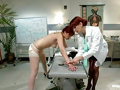 This is the kind of doc that you will barely wait to see. She's a devilish redhead with a passion to dominated, especially other sluts! Her patient came for a routine check and found herself undressed and ass slapped until that sexy ass turned red. Now that the doc slapped her she licks her booty with passion.