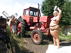 Melinda is so much woman she needs two men to fuck her. Tibor and Gabor lift up her fat folds and spread her booty cheeks. The both suck on her huge melons outside by the tractor. The rubs each part of her big fat beautiful body.