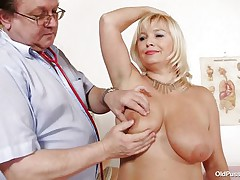 This blonde slut is completely naked at the doctor. The doctor starts examining her big breasts with large and sexy nipples. After that he takes her pulse. The mature women is sitting on the bed now with her big ass at the doctor. He start inspects her ass and large shaved vagina from behind.