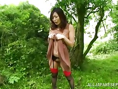 Nature loving Nippon beauty is receiving her dose of wilderness! This cute wench has her hands fastened on a tree branch and gets roughly fucked from behind. Her moans and screams won't help her because there's nobody around. Look at that sweet snatch being rubbed with a sex toy and then drilled hard.