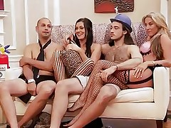 These blonde and black haired babes are with these two guys and looks like they are playing some kind of fun games. But soon they start to have some sexual fun! Right after that, they all get into the bathroom and both of these two horny babes start sucking one of the guy's cock!