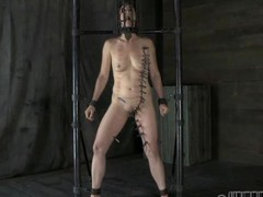 Gagged beauty with clamped nipples gets wild pleasure