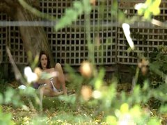 Voyeur masturbation of hairy cum-hole below a tree